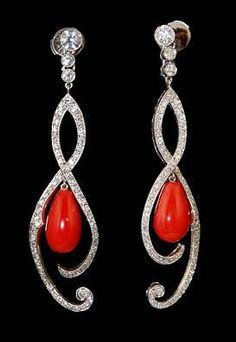 Platinum earrings with diamond and coral.