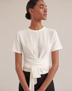 The Jude Short-Sleeve Wrap Blouse is a flattering blouse with wrap detailing creates an elegant silhouette — dressing up beautifully with trousers and heels, or casually with a breezy skirt or denim and slides. Cheap Blouses, Shirt Blouses, Blouses For Women, Mode Outfits, Fashion Outfits, Stylish Shirts, Dress Silhouette, Blouse Outfit, Wrap Blouse