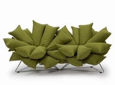 I think you could make this with body pillows anchored to a few pallets. Hanabi sofa by Vivero