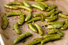 Toss the sugar snaps with the olive oil, oregano, red pepper, salt and pepper.  Place the peas on a rimmed baking sheet lined with Parchment...