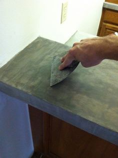 Applying a concrete layering product onto your existing countertops. This looks amazing!