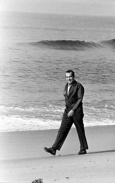 """Nixon walking on beach - no doubt at his San Clemente home, the """"Western White House""""."""