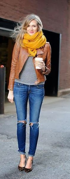 Brown leather jacket, mustard scarf, torn jeans and animal print heels.