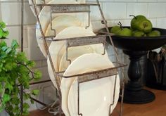 A vintage metal file rack serving as a patinated dish rack