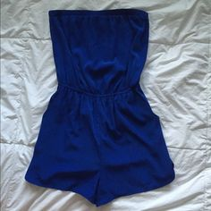 BNWOT blue strapless romper super cute! can be worn casually or formally. ties in the back. only selling because I don't look good on strapless stuff! feel free to make an offer or let me know if you have any questions! Forever 21 Other
