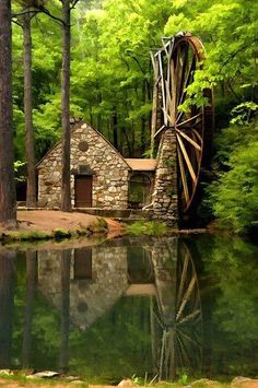 Stone home with a windmill beside the water...sooo beautiful.