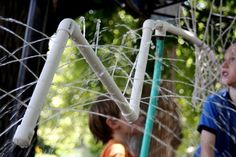 DIY PVC home-style water park.  Connect a hose to PVC that has holes drilled throughout and hang the structure so kiddos can run through. can-i-pay-you-to-make-this