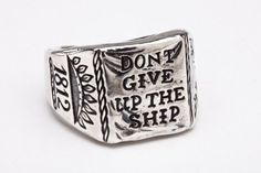 Don't Give Up the Ship ring in oxidized sterling silver by Digby & Iona. Pays homage to the immortal words of Captain Oliver Hazard Perry in