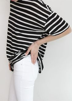 I love the simple top, but with a great shape, with the white pants. And super simple pretty bracelet | CAbi Spring '14 Indie Jean and Sailing Tee