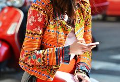 The print on this orange jacket adds extra POP!