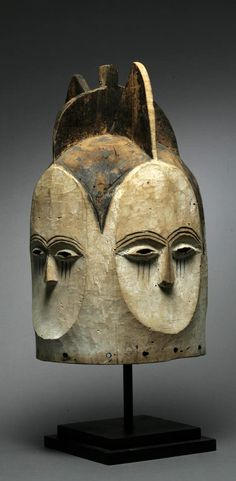 Africa | 'Ngongtanga' helmet mask from the Kwele people of Gabon; wood, white pigment and remains of black pigment. | Collected between 1957 and 1967 in the Kwele territory, not far from the border with Republic of Congo,