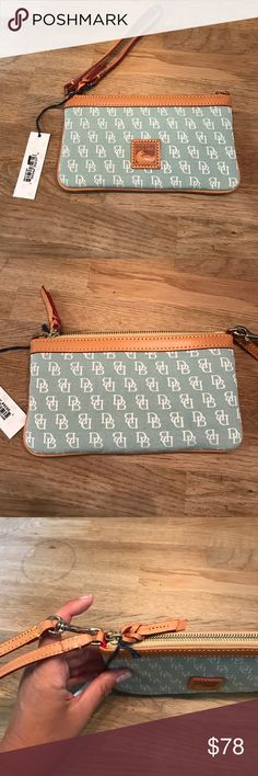 Dooney and Bourke Wristlet NWT Brand new with tags Wristlet by Dooney and Bourke. Still has everything in tact. Stuffing and Dooney registration card inside. Beautiful bra by color blue green. Dooney & Bourke Bags Clutches & Wristlets