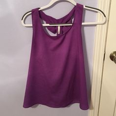 Bow-back tank  BEAUTIFUL purple color  Tank with two bows in the back. Sort of open back (shown in photos). Lovely top for spring and summer! SO CUTE by itself or with a cardigan -- like one I have for sale . Washed only according to care tag. NO TRADES. From a local boutique -- size large BUT I am usually a SMALL and this fits me!! Boutique Tops Tank Tops
