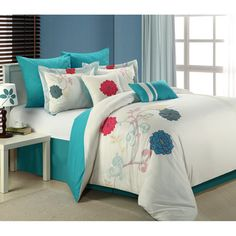 @Overstock - This 8-piece Comforter Set features a romantic mix of florals in vibrant colors. The set is further enhanced with a coordinating aqua bed skirt and throw pillow for a bold look.http://www.overstock.com/Bedding-Bath/Ashley-8-piece-Comforter-Set/7582879/product.html?CID=214117 $76.49