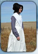 Old Order Amish women and girls wear modest dresses made from solid-colored fabric with long sleeves and a full skirt (not shorter than half-way between knee and floor). These dresses are covered with a cape and apron and are fastened with straight pins or snaps. Almost NEVER buttons