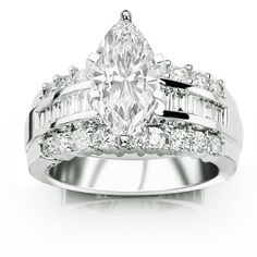 A marquise surrounded by baguettes and round brilliant diamonds...oh my!