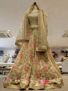 Cream Net Lehenga Choli with Stone Work