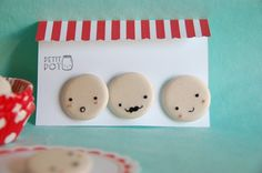 Adorable! these are badges, but would be cute to make fabric-covered buttons like this too