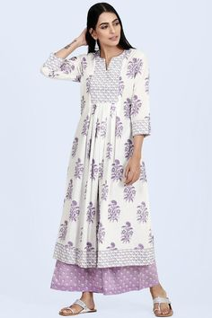 Add a royal touch to your everyday look with the Isfahan Mahira Kurta. The flowy round neck, A-line kurta is replete with embroidered sequins on the yoke and a box pleated front. Pair it with a lavender farsi or palazzo and dupatta from the Isfahan collec Kurta Patterns, Dress Patterns, Box Pleated Dress, A Line Kurti, Kurti Styles, Simple Fall Outfits, Embroidery Suits Design, Kurta Designs Women, Ethnic Wear Designer