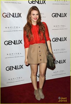Holland Roden walks the red carpet at the opening of new bar Riviera 31 (January 15, 2013). Holland is wearing a Pins & Needles top, J. Crew skirt, Coach boots and a Rebecca Minkoff bag.