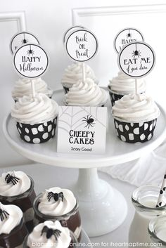 Cute and FREE Halloween party printables -love these cupcake toppers!