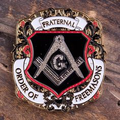 "THIS ITEM CAN ONLY BE SHIPPED WITHIN THE U.S. This uniquely shaped 1.75"" coin is gold with black, white, and red detailing. The front side displays the detailed Masonic Square and Compasses in shiny n"