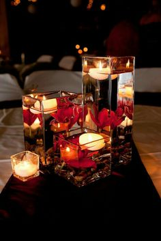 Wedding Centerpieces square glass vases, floating candles and red orchids Fall Wedding Centerpieces, Wedding Table, Our Wedding, Wedding Decorations, Centerpiece Ideas, Red Centerpieces, Red Table Decorations, Floating Flower Centerpieces, Wedding Reception