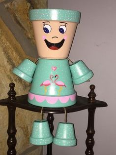 Flower Pot People with pink flamingos by ShadyPenguins on Etsy … Clay Pot Projects, Clay Pot Crafts, Diy Clay, Diy And Crafts, Flower Pot Art, Clay Flower Pots, Flower Pot Crafts, Flower Pot People, Clay Pot People
