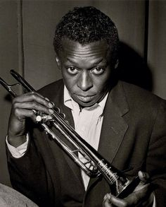 Herman Leonard     Miles Davis at Birdland , New York City      1949