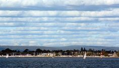 Australian Weather Calendar 2011. December: Cloud streets march over the Swan River, Western Australia, in the afternoon of 5 July 2009. Cloud streets are cumulus clouds that occur in an organised, horizontal, linear formation. Picture: John Terni