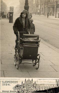 Pushing the pram in London in 1934 by lovedaylemon, via Flickr
