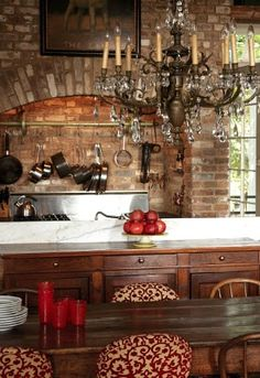 Love the chandy!!! I have exposed brick in my kitchen and it is HARD to keep clean. It is not an easy wipe surface to wipe down from kitchen build up!!