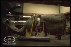 Character Creators Rob Ramsdell and Trevor L. Hensley maneuver the giant leg of JURASSIC PARK III's Animatronic Spinosaurus in preparation for molding.