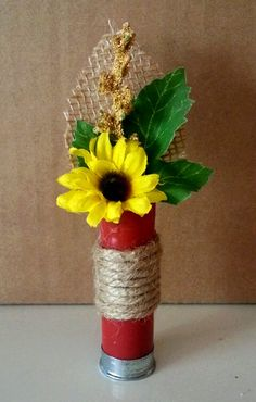 Dads boutonniere. Shotgun Shell with sunflower. Silk flowers and burlap.