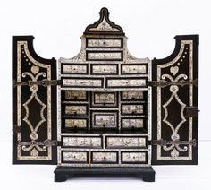 Antique Italian Ebonized & Ivory Inlaid Cabinet on Stand 59.25''x21''x14.75''. Cabinet has interior drawers with ivory decorated panels depicting genre scenes and putti. Considered a collectors or table cabinet. Overall edge chipping with some repaired panels. 19th century, Italy.