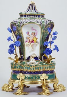Pot-pourri fontaine or pot-pourri à dauphins, Sèvres porcelain factory, c. 1760, Soft-paste porcelain, bleu lapis and apple green ground, gilded decoration and gilt bronze.