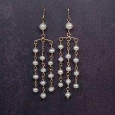 Beautiful and elegant pearl tassel earrings. I designed it and made it by hand. Its comfortable to wear, perfect for sensitive skin. It can be a perfect gift for yourself or your friends.