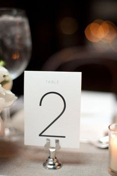 As a rule, table numbers should be easy to see and identify. The minimalist trend just makes your job easier by ensuring that the digits are large, clear, and easy to see, even after a few glasses to champagne. Keep a simple font and let the black and white contrast do the job for you.