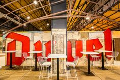 Too Many Agencies - Duvel Venuez << Graphic Design- Scenography - Beer store - Red graphic - Logo - White composition - Rusted steal - White table - White interior - Bar - Counter >>