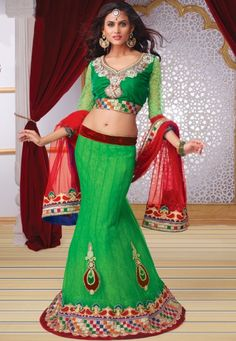 Green Net flared lehenga designed with Multi Thread And Sequence Work And Handwork Butta Appli que With Beautiful Diamond Work . As shown in the photo Green Velvet And Jacquard Net Sleeves choli is available.