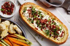 Creamy Spring Onion and Bacon Dip Loaf - Entertain a crowd with this creamy spring onion and bacon dip served in a fresh cob loaf.