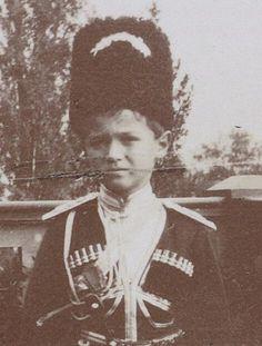 """Close-up photo of Tsarevich Alexei Nikolaevich Romanov of Russia in his Cossack uniform. """"AL"""""""