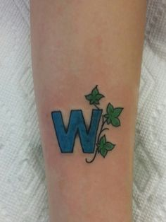 Cubs symbol tattoo with the ivy wraping around the wrist for World series tattoo