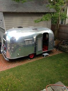 When our Bunkhouse Airstream is not in use we have it parked next to the house as a guest house. I love the brick pad that they have theirs on! 1958 18 foot airstream $23000
