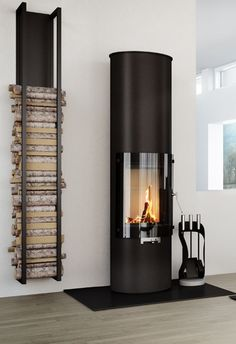 tall wood burning stove and wood storage