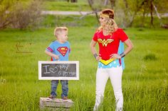 Mommy and son in their super hero costumes