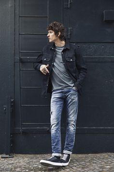 Black denim jacket with blue jeans