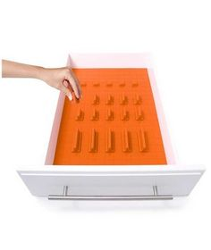 If you're constantly frustrated by cluttered kitchen drawers, you'll want to invest in one of these silicone mats. Cut it to fit the unruly space, then position the dividers to keep everything in place.