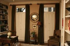 This classic designed library shows Raised Panel shutters in double hung configuration. The top half. Interior Storm Windows, Interior Shutters, Interior Design Courses Online, Interior Design Tips, Raised Panel Shutters, Transom Windows, Window Treatments, Entryway, Lights