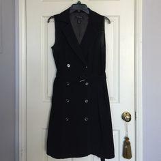 Black sleeveless double breasted coat dress Beautiful black double breasted sleeveless coat dress from White House Black Market. White House Black Market Dresses Midi